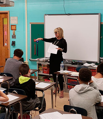 Mary Ledbetter works with students at Deptford Township Schools in NJ